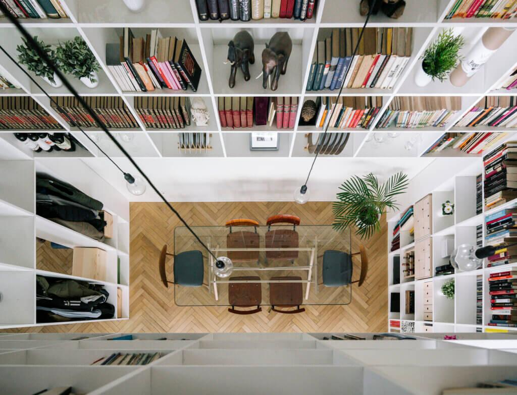 Top-down photo of a home library. The enlarged ceiling made it possible to create many spaces for books.